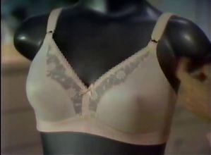 Two broads try on Playtex bras.